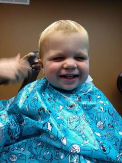 Photo of kids first haircut at Luminosity Salon.